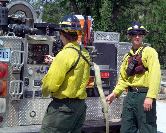 Wind Cave firefighters Mike Mattmiller and Matt Koller ready equipment in case fire breaks out in or near the park.