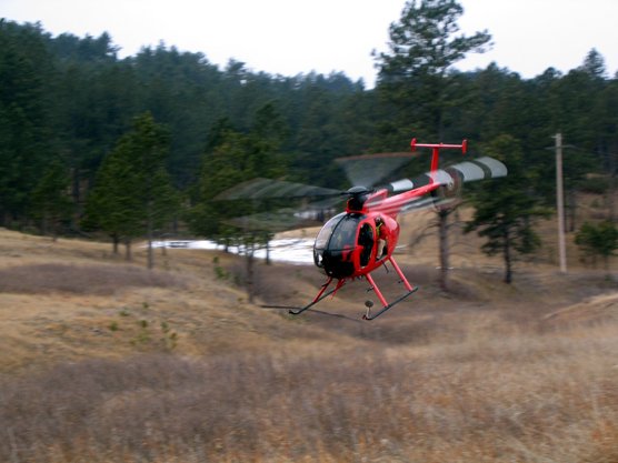 Helicopter from Leading Edge Aviation taking off to collar elk in Wind Cave National Park.