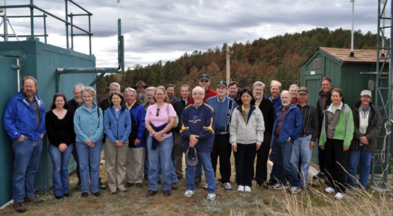 Members of the IMPROVE steering committee standing by monitoring equipment at Wind Cave National Park