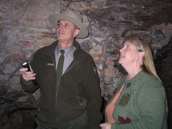 Ranger showing visitor a room in Wind Cave.