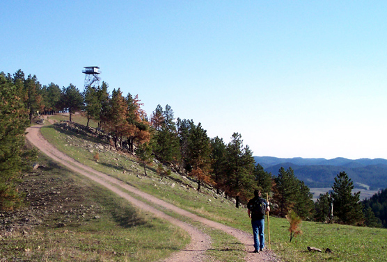 A hiker approaches the Rankin Ridge fire tower, which was constructed in 1956.
