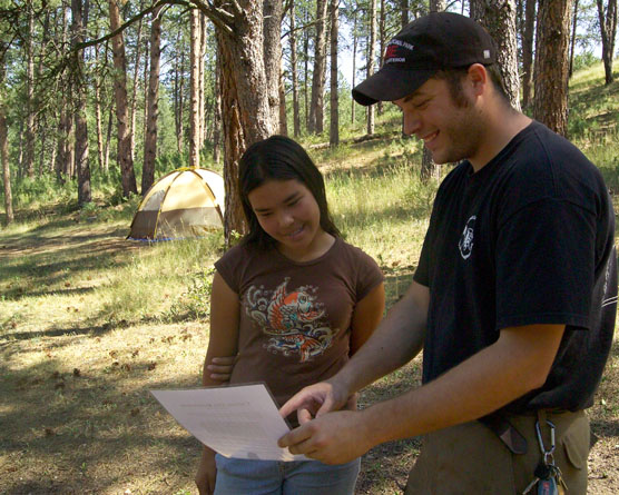 Forestry Technician Rob Schultz explains Wind Cave National Park's fire restrictions to Vanessa Mendoza from Chino, California