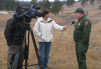 Wind Cave's Park Biologist gives an interview to a television reporter.