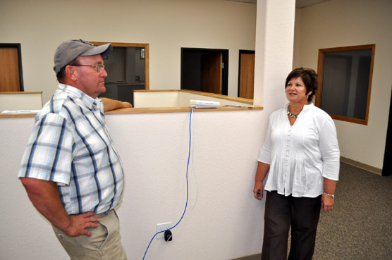 Brian Spitzer, President of Spitzer Construction, Inc., discusses the renovated office building with Andrea Kern, Human Resource Officer for the West SHRO.