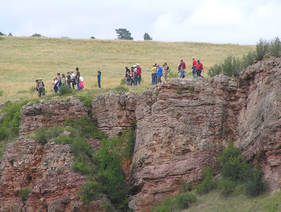 A ranger-led tour overlooking a cliff.