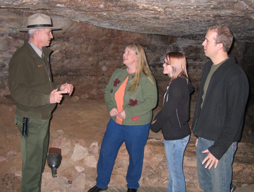 Ranger Jack Howell talking with visitors in the Assemble Room in Wind Cave.