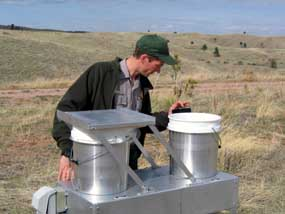Wind Cave National Park Physical Science Technician Marc Ohms working on air quality monitoring equipment.