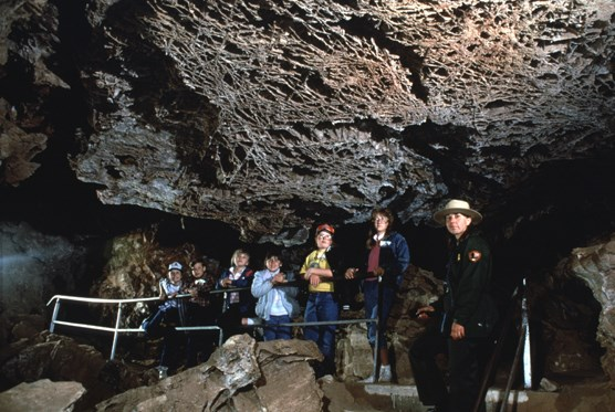 Ranger leading a tour in Wind Cave to a group of visitors