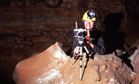 Karen Rosga sets up a camera to take a picture in Wind Cave