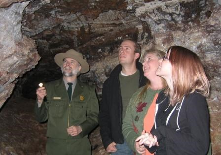 A ranger highlights cave features to visitors inside Wind Cave