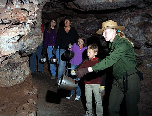 Ranger Tiffiny Durham and visitors on Candlelight Cave Tour