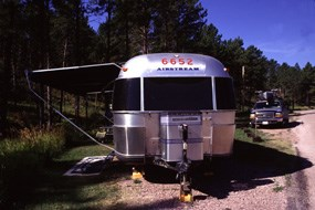 Silver airstream camper parked at Elk Mountain campground