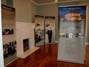The temporary exhibits at the Clinton Birthplace Home feature freestanding panels with information and photographs about Mr. Clinton's early life in Hope, Arkansas.