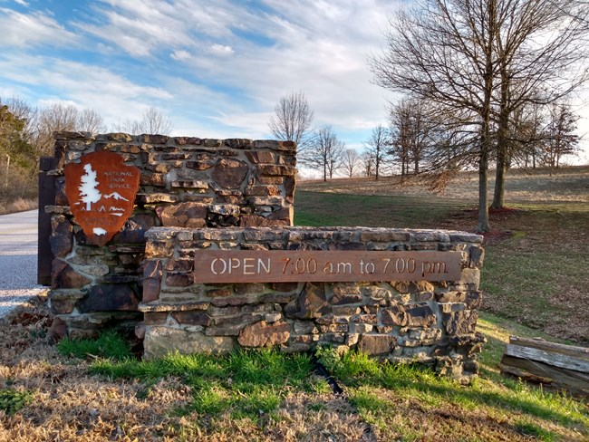 Stone gate with sign at entrance of Wilson's Creek National Battlefield