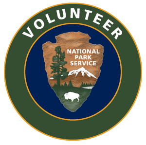The NPS volunteer logos with arrowhead in the center of the circles