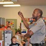 A William Howard Taft NHS ranger speaks with kids in the classroom
