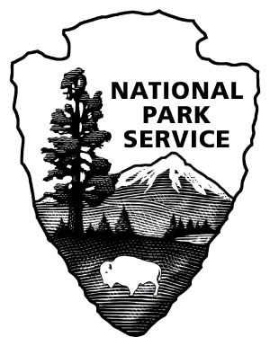 The National Park Service arrowhead logo showing a bison, trees, mountains and water