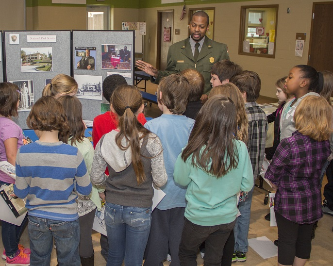 Ranger Wood talks with children
