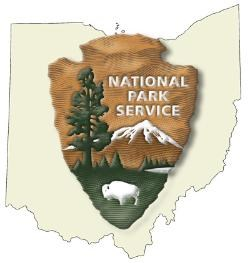 The NPS arrowhead logo showing a bison, a tree, a lake and mountain range all on an arrowhead outline.  A larger state of Ohio outline in the background.