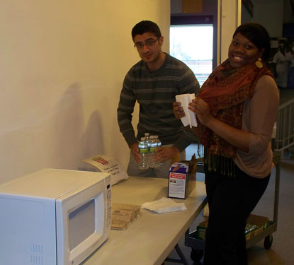 Barbara and Jamal help set up for the Winter Film Festival.