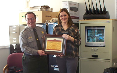 John presents Stephanie with a Certificate of Appreciation.