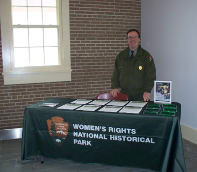 John Stoudt, Volunteer Coordinator, at a table during the It's a Wonderful Life Festival.