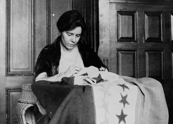 Alice Paul with suffrage flag