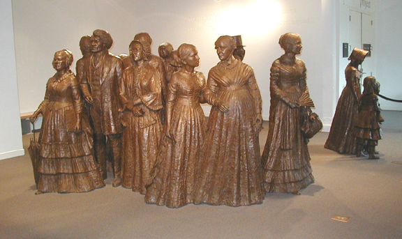 group of life-size bronze statues representing some of the particpants of the First Women's Rights Convention