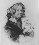 Elizabeth Cady Stanton holding her daughter Harriet in 1856.
