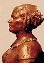 Image of the statue of Elizabeth Cady Stanton in profile. The statue is in the park visitor center lobby.