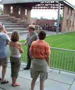 John Stoudt talking to a group on a walking tour. In front of the Wesleyan Chapel.