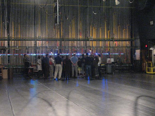 A tour group observes the Filene Center fly lines