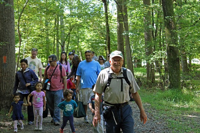 A park volunteer leads a guided hike on the Wolf Trap Trail.