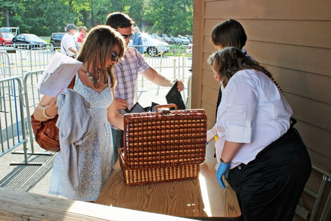 Couple having basket inspected for Filene Center performance