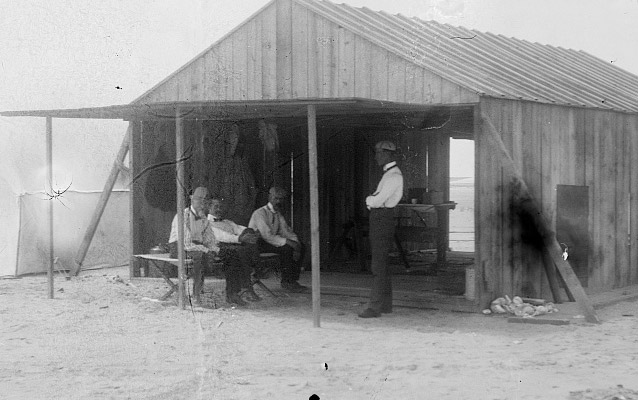 Wright brothers and visitors at camp, 1901