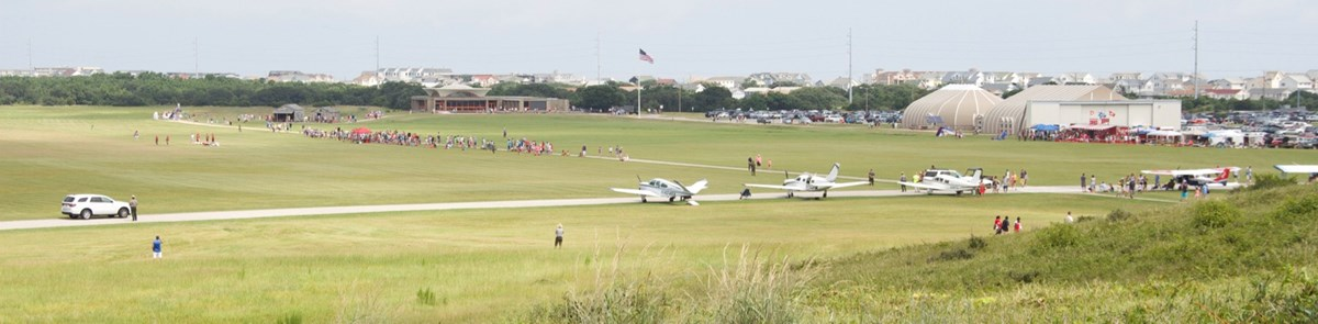 Visitors and plans of the grassy mall during National Aviation Day