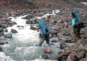 Crossing an icy glacial stream