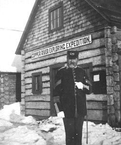 Historic photo of Captain Abercrombie in front of wood Copper River Exploring Expedition building.