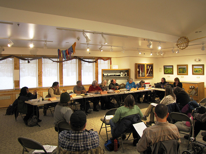 Subsistence Resource Commission members gathered around a table discussing issues.