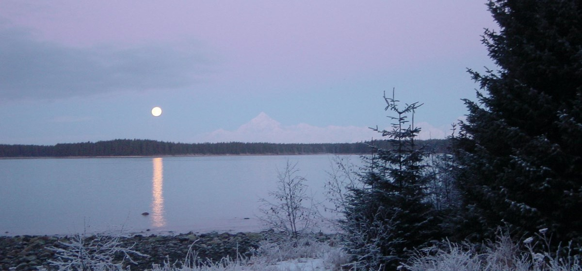 The moon rises over Mt. St. Elias.