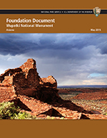 Wupatki Foundation Document cover featuring a photo of the pueblo beneath cloudy skies. Click to open the document.