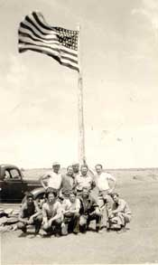 Group of workers around flagpole