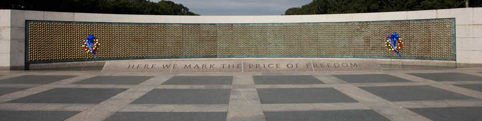 the words 'Here we mark the price of freedom' on a plaza in front of wall of stars