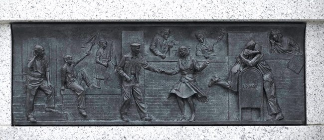 Image of Bas Relief: People dancing in the streets and kissing during Victory in Japan Day.