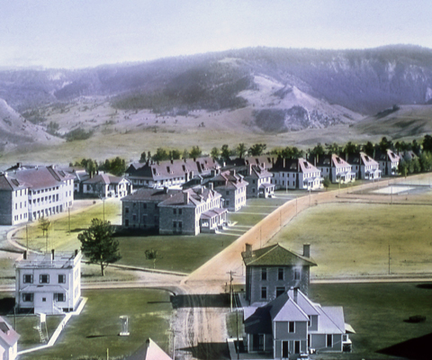 A historical photo of buildings surrounded by green lawns