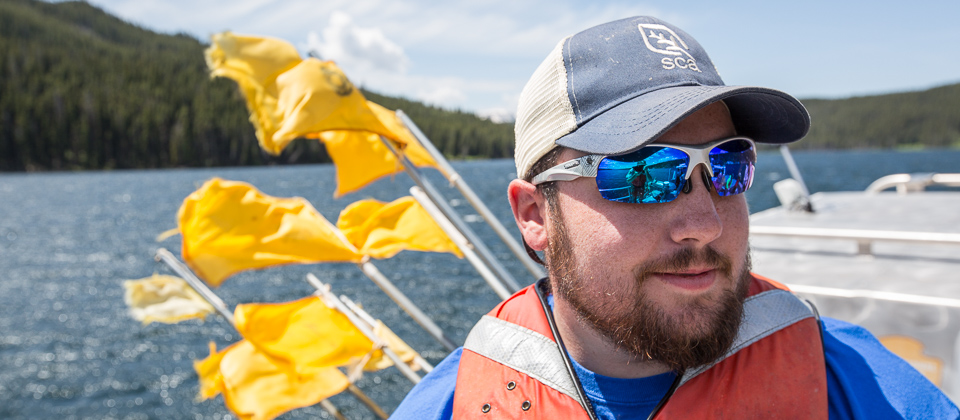 An SCA working with fisheries crews on Yellowstone Lake