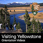 Visitors watch for wildlife along the Yellowstone River in Hayden Valley.