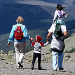 A family takes in the view from the top of 10,000-foot Mt. Washburn.