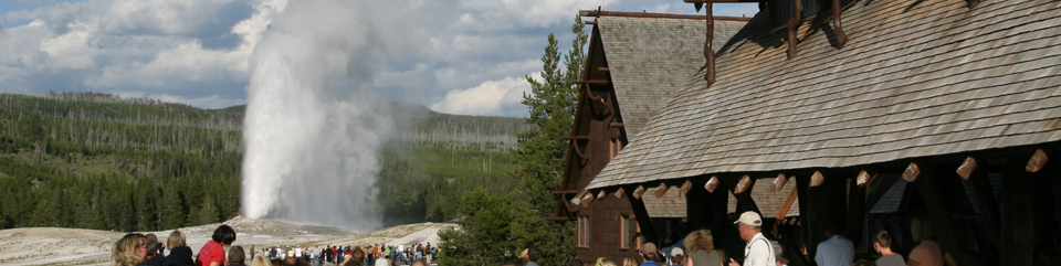 Visitors enjoy an eruption of Old Faithful from the Inn.