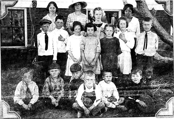 Mammoth Hot Springs School students are pictured in this 1921 photo with their teacher, Ellen Mariott (with hat). The three children who developed a plan to allow Santa Claus into Yellowstone Park on Christmas Eve are seated in the front row: Don Fraser, far left, Bud Trishman, fourth from left, and Spencer Dupre, far right. Photo courtesy of Don Fraser.